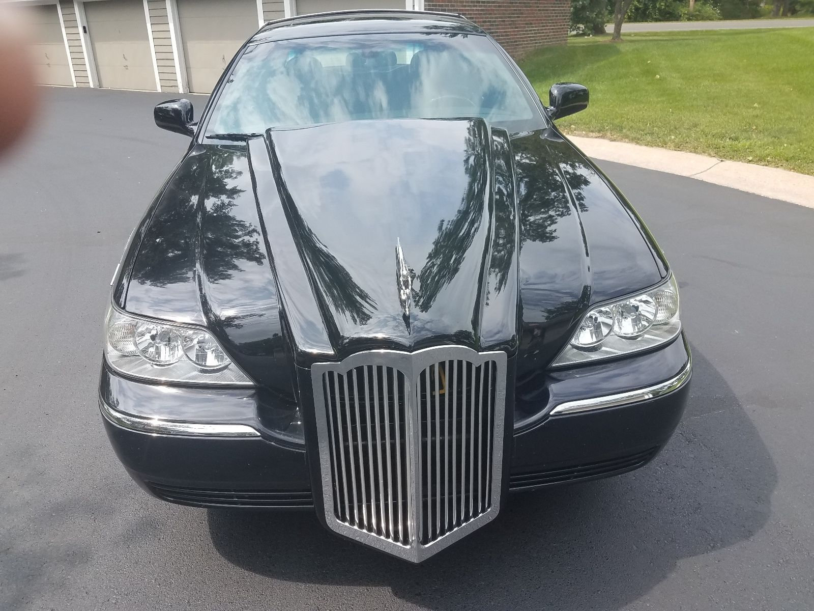 Someone Needs To Put This Abomination Out Of Its Misery  2006 Packard  Lincoln Town Car
